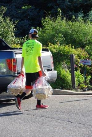 Reid helps unload the raffle items